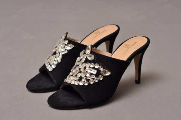 Gem stone heel slide