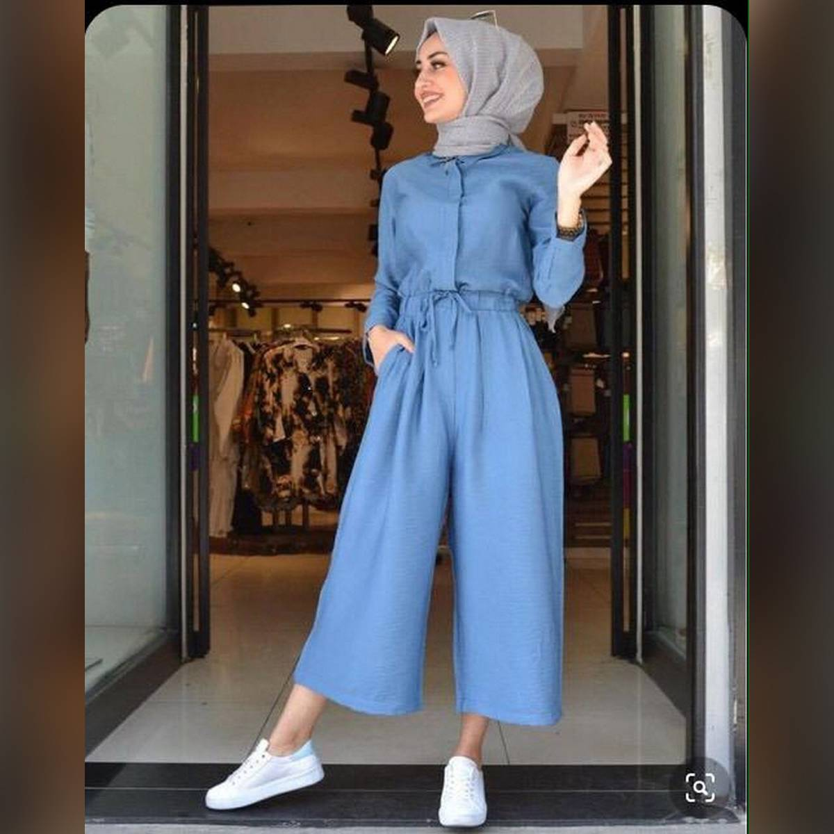 Jumpsuit with belt and button