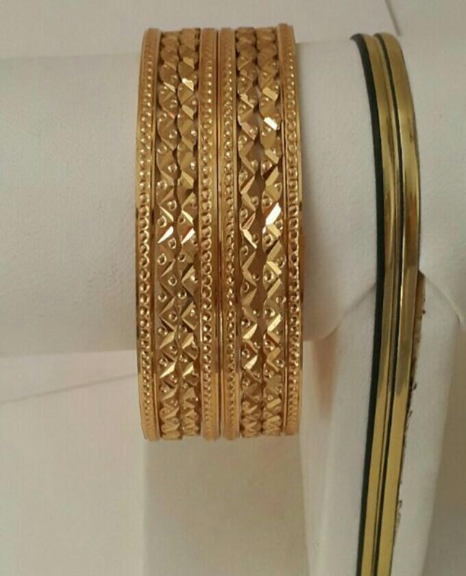 Golden Alloy 8 piece Bangles for women