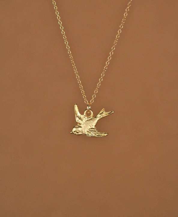 antique bird pendant